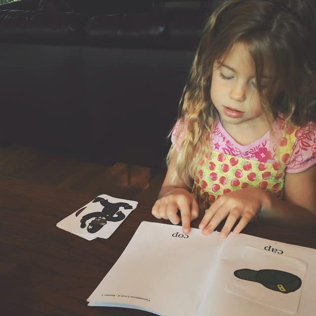 #homeschool mom confession- I do not enjoy teaching phonics/reading. But this girl sure is rocking it. I DO enjoy watching new parts of my children's personalities emerge in the 'school' setting. This girl is eager, determined, and not easily frustrated. #learningtoread #kindergarten #peytonruth