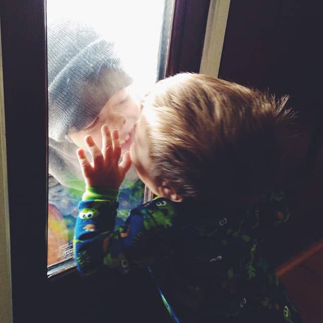Little brother is stuck inside with a fever on this chilly afternoon. He flings a fit everytime big brother moves away from the window and kisses him through the glass each time he returns. #bigbrotherlittlebrother #michaeljoseph #jonjon