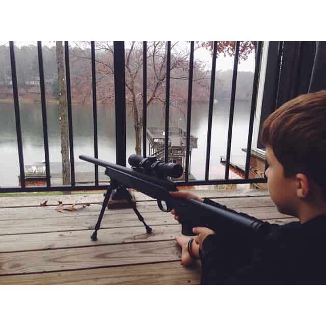 Shooting at the ducks in the lake... One way to make this boy happy on a rainy afternoon. (Don't worry, they are too far away for him to actually hit) #countrylife #michaeljoseph #lakelife #rainydayfun
