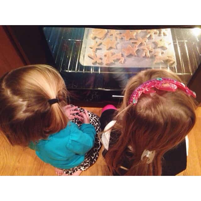 Waiting is so hard... And they don't even know that they must also wait for them to cool before icing them. #gingerbread #littlegirls #cookingwithMomma