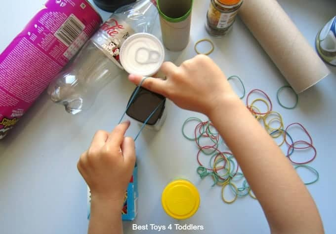 Rubber Band Fine Motor Play with Items from Recycle Bin